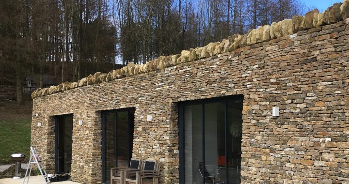 eco slim doors in stone wall